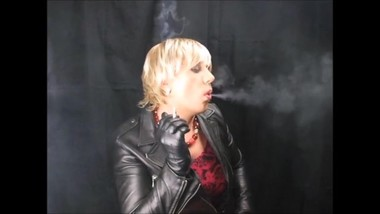 hot blonde woman smoking in leather gloves and jacket