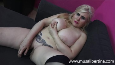 Busty mom enjoys a big black dildo by Musa Libertina