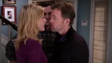 Modern Family - Claire is kissed by Tad twice