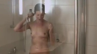Young MILF with big ass taking a shower