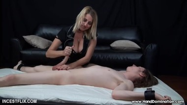 Twisted mom gives femdom handjob to her son