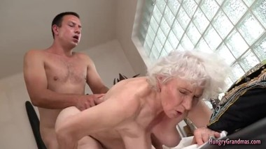 Horny granny cant resist fucking with a hard cock