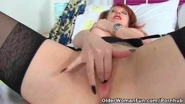 English milf Red fills up her fanny with fingers