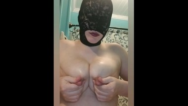 Masked mommy playing with her milk, squirting, sucking, and pumping