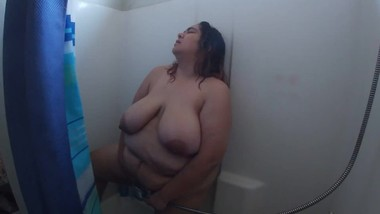 Latina with big breasts cumming after masturbating in the shower
