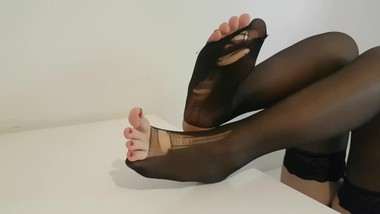 Lara's amazing ripped pantyhose feet on desk