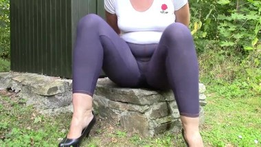Handcuffed Angela peeing in jeans leggings.