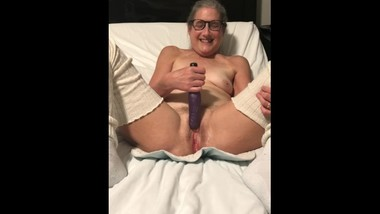 Milf 60 year old mom fucks dildo in leggings and glasses