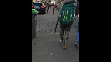 Candid hippie girl barefoot in the street incredibly dirty soles