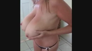 Sexy Milf with Huge Breasts showing he