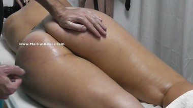 Masseur Fingering wife's pussy and cumming on her legs at a massage room