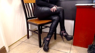 Shiny Black Leather Leggings Legs Crossed