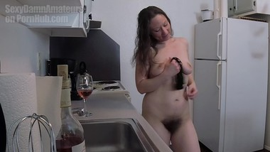 Hairy natural cheerleader stripping in the kitchen