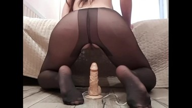 Dildo ride rear view in black pantyhoses