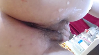 Big ass mom pleasures her hairy cunt in the bathroom