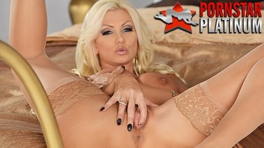 Busty blonde pornstar MILF Brittany Andrews fingers her shaved pussy