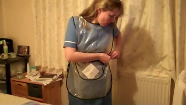 Sexy mature nurse in plastic apron and rubber gloves