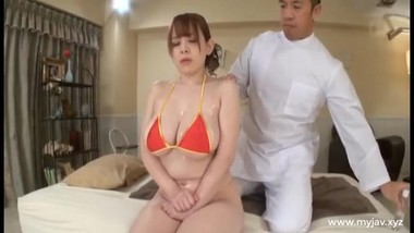 Lucky man gives amassage and fucks a Japanese woman with huge tits