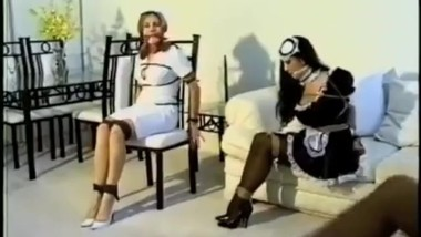 Two women in bondage and submissive by another woman